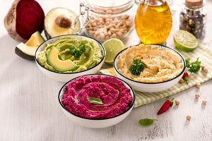 Colorful hummus dips with vegetables