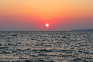 Fantastic crimson sea ocean sunset horizon sky photo