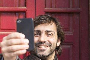 Man with beard take selfie