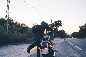 Man gets on the bike