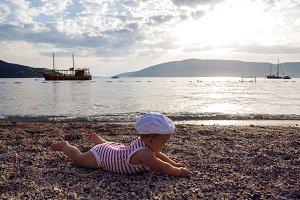 baby boy lying on the beach