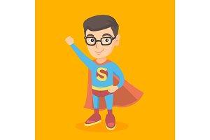 Caucasian boy playing in a superhero.