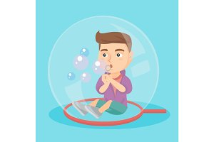 Caucasian boy sitting inside a big soap bubble.