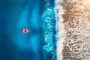 Aerial view of woman swimming in the sea