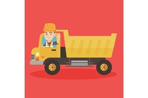 Little caucasian driver driving a dump truck.