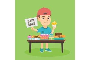 Little caucasian boy running charity bake sale.