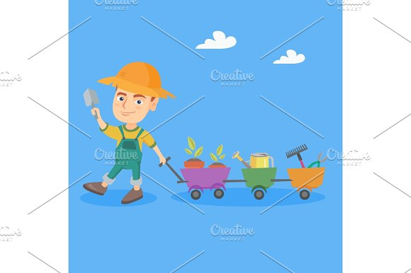 Boy Pushing A Cart With Plants And Garden Tools