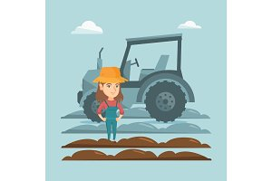 Farmer standing on the background of tractor.
