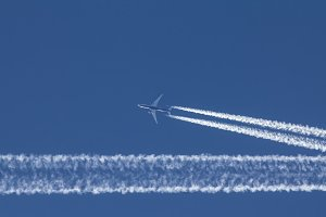 Passengers jet is flying in perfect blue sky