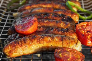 Grilling sausages on barbecue grill. Selective focus.