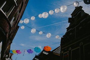 Paper lanterns on the sky background