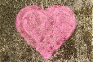 Chalk heart painted on a wall