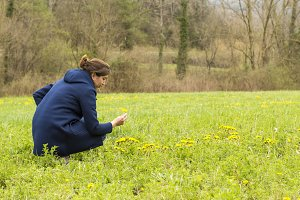 Woman picking flowers in the field