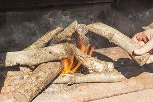Man making a bonfire.