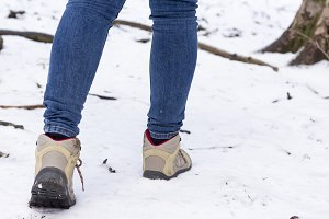 Hiking boots against snow