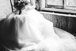 Bride in her gown with a bouquet