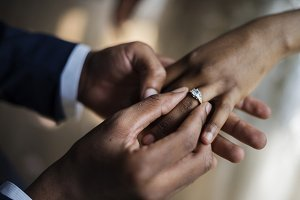 Groom Put on Wedding Ring to bride