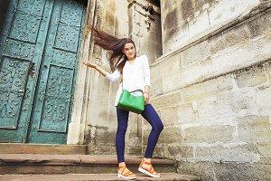 Pretty girl with green handbag