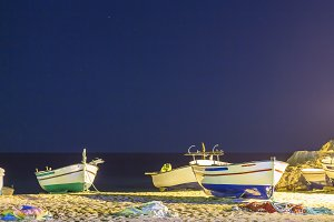Fishing boats on the sand beach
