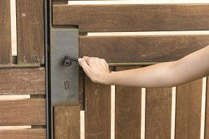 Woman hand open wooden door