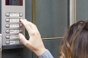 Woman calling on the intercom