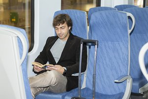 Male traveler in a train