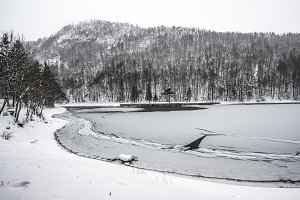 Peaceful winter landscape by river
