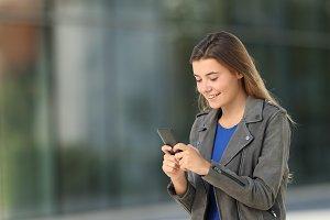 Single fashion teen using a phone