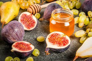 Autumn fruits with honey