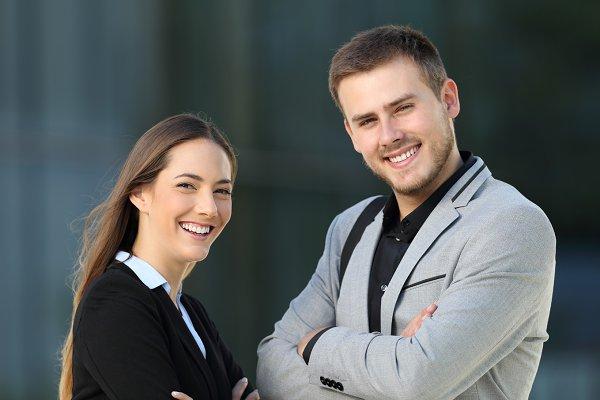 Couple of executives posing