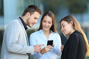 Group of three executives talking