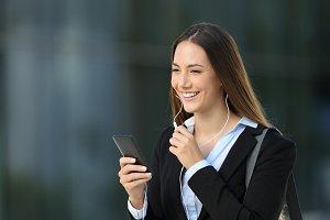 Executive talking with earphones