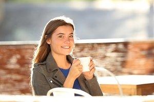 Happy girl drinking coffee