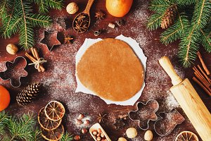 Gingerbread cookie dough and decorations for Christmas winter holidays