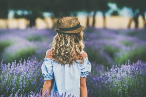 Woman standing in lavender field