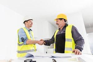 Architect and construction engineer handshake.