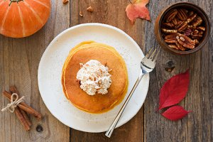 Pumpkin pancakes with cream and cinnamon