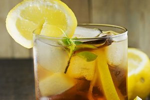 iced tea with lemon, on rustic woode