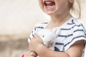 little girl with toy lamb