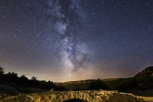 Milky way over a rock bridge