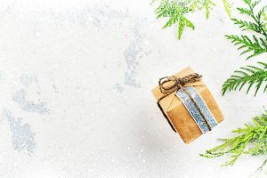 Small gift box on white christmas background