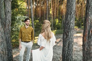 The first meeting of bride and groom. The bride goes to the groom. Autumn wedding ceremony outdoors. Artwork