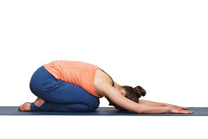 Woman relax in Hatha yoga asana Balasana child pose