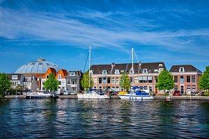 Boats and houses on Spaarne river. Haarlem, Netherlands