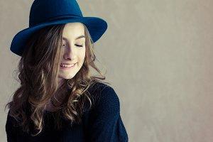 Portrait of beautiful girl in a hat