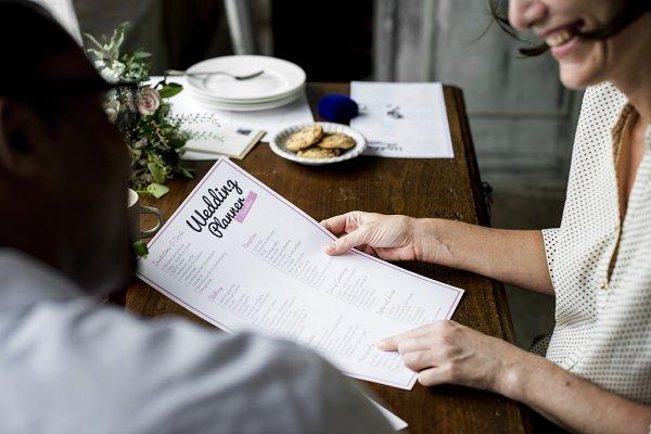 Hands Holding Wedding Planner