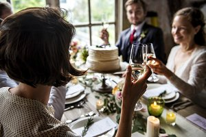 People Cling Wine Glasses on Wedding