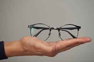Glasses on human lay hand
