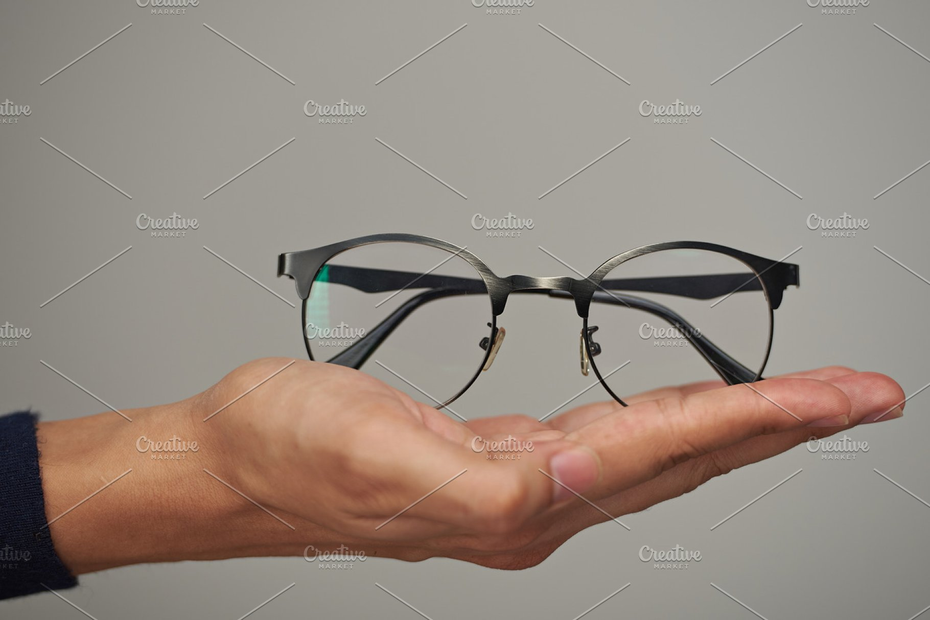 75a39103cdab Glasses on human lay hand ~ Health Photos ~ Creative Market