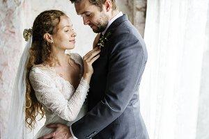 Bride Helping Groom Dressing Up